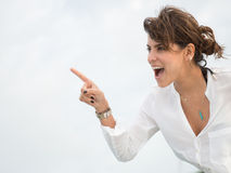 Surprised woman pointing Royalty Free Stock Photos