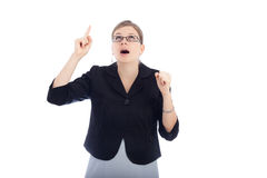 Surprised woman pointing up Stock Photography