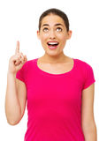 Surprised Woman Pointing Upwards Royalty Free Stock Image