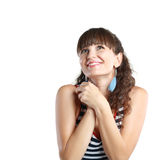Surprised woman. Portrait of a surprised middle age woman with hands over her mouth laughing against white background Stock Images