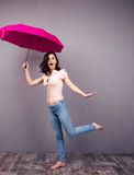 Surprised woman posing with umbrella Royalty Free Stock Images