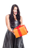 Surprised woman with present Royalty Free Stock Image