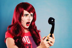 Surprised Woman with Professional Comic Pop Art Makeup. Surprised Woman with Professional Comic Pop Art Make-up and Retro Phone Royalty Free Stock Photos