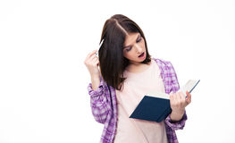 Surprised woman reading book Royalty Free Stock Photo
