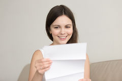 Surprised woman reading letter with unexpected good news, feelin Stock Photography