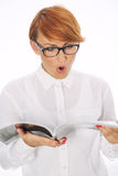 Surprised woman reading the newspaper royalty free stock image