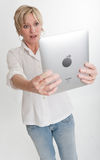 Surprised woman reading from a PC tablet Royalty Free Stock Photo