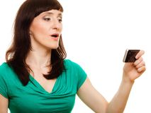 Surprised woman reads message on her mobile phone Stock Photography