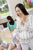 Surprised Woman Receiving Baby Shower Carriage Royalty Free Stock Photography