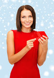 Surprised woman in red dress with gift box Royalty Free Stock Image