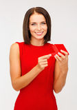 Surprised woman in red dress with gift box Stock Photo