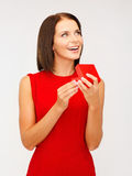 Surprised woman in red dress with gift box Stock Images