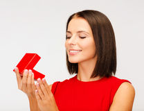 Surprised woman in red dress with gift box Royalty Free Stock Photos