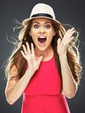 Surprised woman in red dress studio portrait. Royalty Free Stock Photos