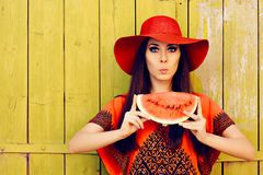 Surprised Woman in Red Hat with Watermelon Slice Royalty Free Stock Images