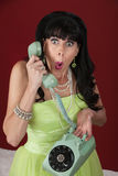 Surprised Woman on Rotary Phone Stock Photography