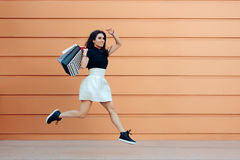 Surprised Woman Running With Shopping Bags in Summer Sale Season Stock Photos