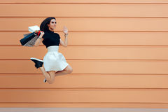 Surprised Woman Running With Shopping Bags in Summer Sale Season Royalty Free Stock Photo