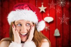 Surprised woman in santa costume against digitally generated background. During christmas time Royalty Free Stock Photo