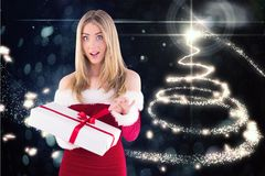 Surprised woman in santa costume opening a gift box Stock Image
