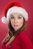 Surprised woman with santa hat Royalty Free Stock Photography