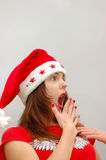 Surprised woman in Santa hat stock image