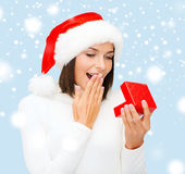 Surprised woman in santa helper hat with gift box Royalty Free Stock Images