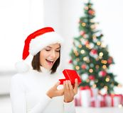 Surprised woman in santa helper hat with gift box Stock Image
