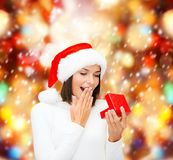 Surprised woman in santa helper hat with gift box Royalty Free Stock Photos