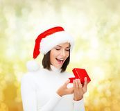 Surprised woman in santa helper hat with gift box Royalty Free Stock Photography
