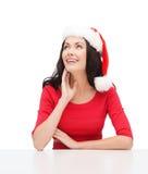Surprised woman in santa helper hat looking up Royalty Free Stock Photos
