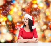 Surprised woman in santa helper hat looking up Royalty Free Stock Photo