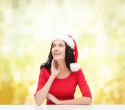 Surprised woman in santa helper hat looking up Royalty Free Stock Photos