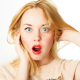 Surprised woman screaming amazed in joy. Surprised excited woman screaming amazed in joy Royalty Free Stock Images