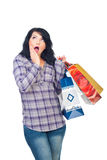 Surprised woman with shopping bags Stock Images