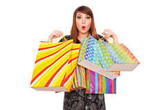 Surprised woman with shopping bags Stock Image