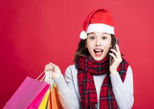 Surprised Woman shopping for christmas gifts Stock Photo