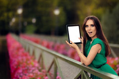 Surprised Woman Showing a Digital Tablet Display Stock Photos