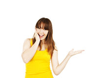 Surprised woman showing product Royalty Free Stock Photos