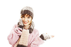 Surprised woman showing product. Winter style. Royalty Free Stock Image