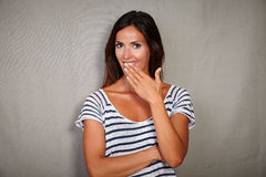 Surprised woman smiling with hand to mouth Royalty Free Stock Images