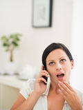 Surprised woman speaking mobile phone Stock Photography