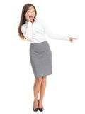 Surprised woman standing isolated. Surprised woman pointing. Pretty businesswoman standing in full length isolated on white background Royalty Free Stock Photo
