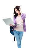 Surprised woman standing and looking on laptop screen Stock Images
