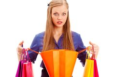 Surprised woman standing with opened shopping bag Royalty Free Stock Photos