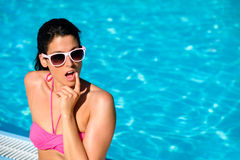 Surprised woman on summer vacation at swimming pool Royalty Free Stock Photo