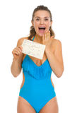 Surprised woman in swimsuit holding air tickets Royalty Free Stock Photos