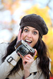 Surprised woman taking photos in autumn Royalty Free Stock Photos