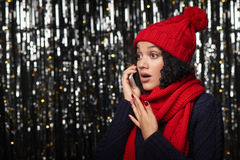 Surprised woman talking on cell phone Stock Image