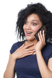 Surprised woman talking on mobile phone Royalty Free Stock Images